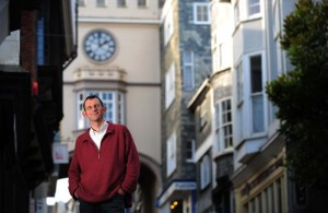 Rob Hopkins, with a familiar Totnes building in the background.