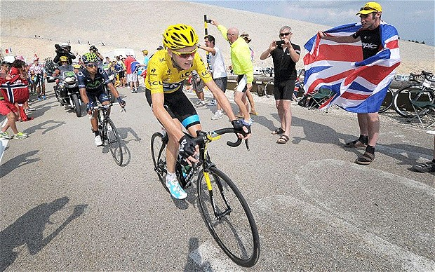 Heading for glory: Chris Froome is cheered on by a British fan Photo: PA