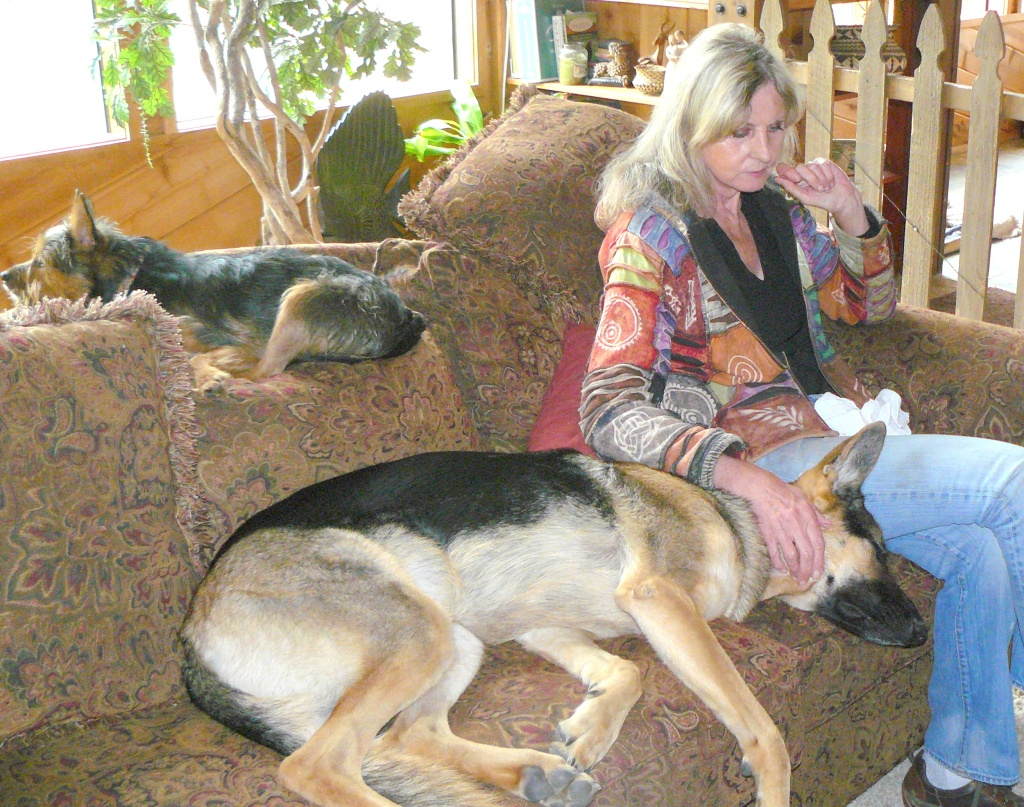 Sweeny on back of settee, Cleo loving Jean.