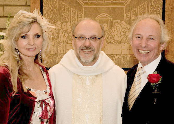 Fr. Dan Tantimonaco with the newly weds!