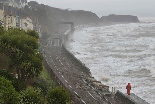 rail-emergency-workers-inspect-damaged-track-along-the-seafront-at-dawlish-in-south-west-england-