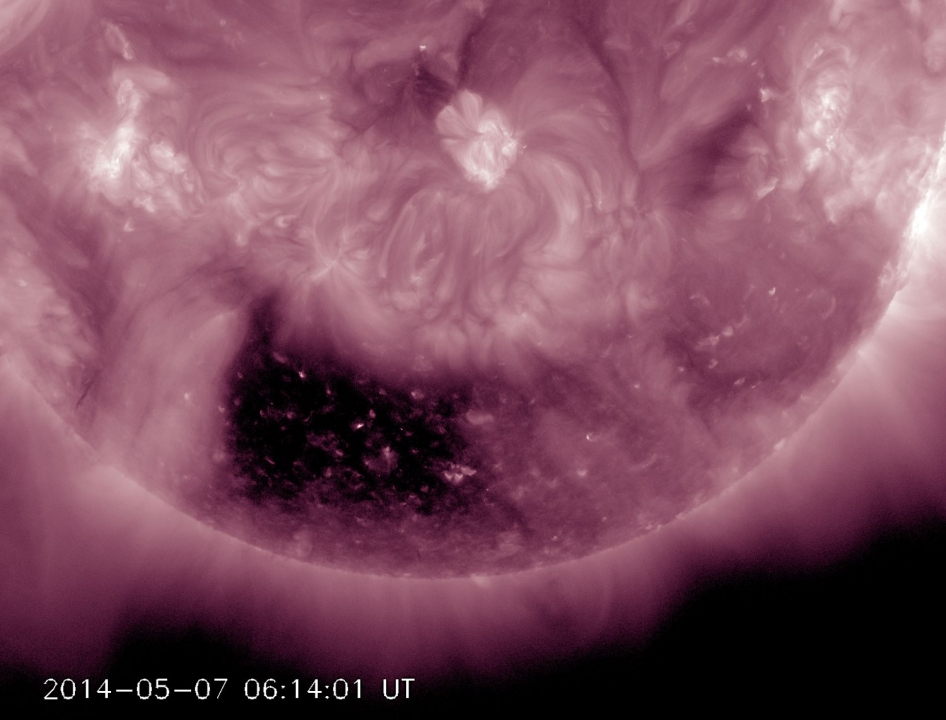 Coronal Hole Squared A coronal hole, almost square in its shape, is one of the most noticeable features on the Sun of late (May 5-7, 2014). A coronal hole is an area where high-speed solar wind streams into space. It appears dark in extreme ultraviolet light as there is less material to emit in these wavelengths. Inside the coronal hole you can see bright loops where the hot plasma outlines little pieces of the solar magnetic field sticking above the surface. Because it is positioned so far south on the Sun, there is less chance that the solar wind stream will impact us here on Earth. Credit: Solar Dynamics Observatory/NASA