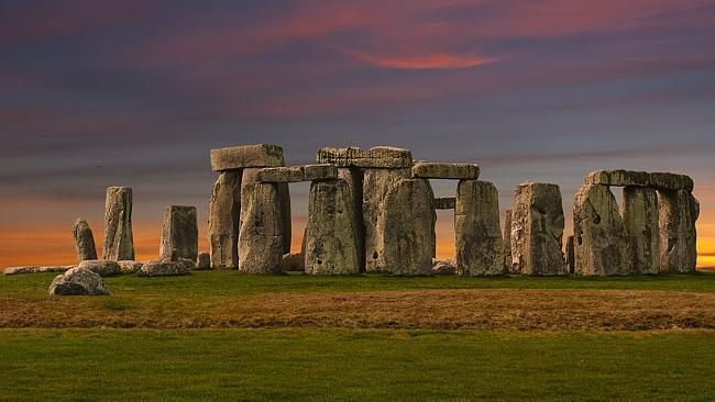 Stonehenge at Dawn.  On the morning of Mid-Summer's Day the sun rises exactly over the heel stone.