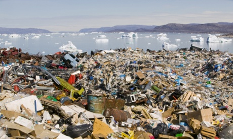 Rubbish dumped on the tundra outside llulissat in Greenland stand in stark contrast to icebergs behind from the Sermeq Kujullaq or llulissat Ice fjord – a Unesco world heritage site. Photograph: Global Warming Images/WWF-Canon