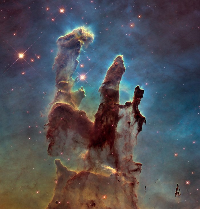 The NASA/ESA Hubble Space Telescope has revisited one of its most iconic and popular images: the Eagle Nebula's Pillars of Creation. This image shows the pillars as seen in visible light, capturing the multi-coloured glow of gas clouds, wispy tendrils of dark cosmic dust, and the rust-coloured elephants' trunks of the nebula's famous pillars. The dust and gas in the pillars is seared by the intense radiation from young stars and eroded by strong winds from massive nearby stars. With these new images comes better contrast and a clearer view for astronomers to study how the structure of the pillars is changing over time.