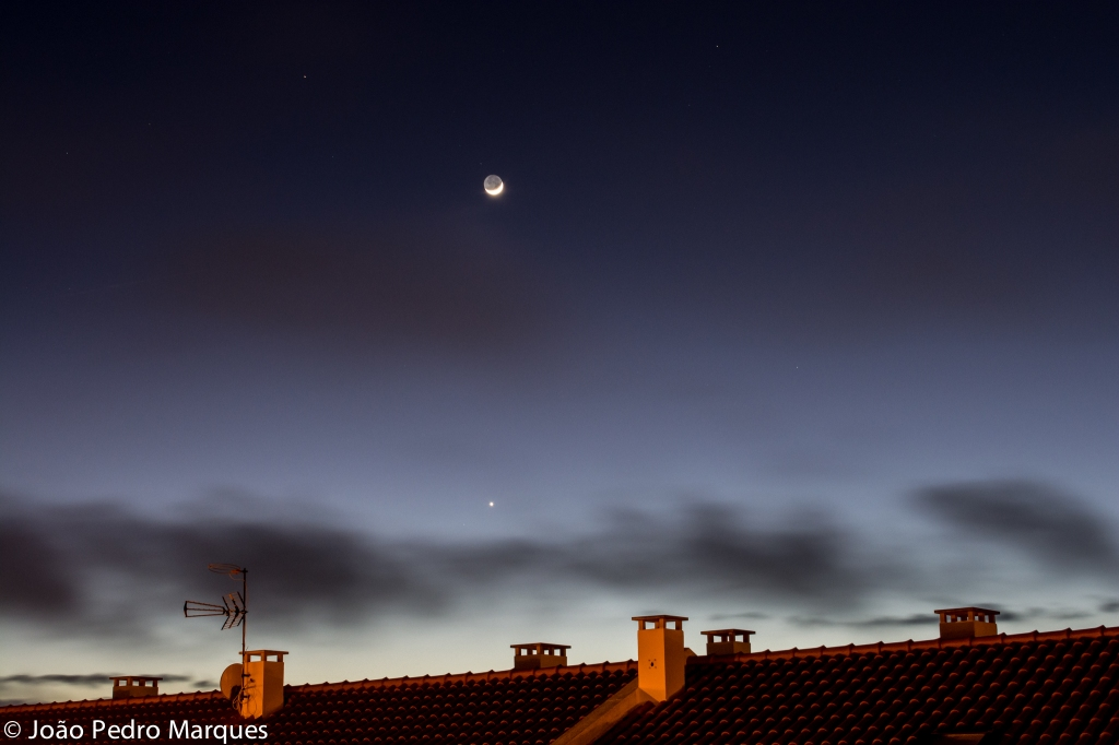"João Pedro Marques caught bright Venus and the waxing moon on the evening of January 22, 2015, from Portugal. The reddish ""star"" above and to the left of the moon is Mars."