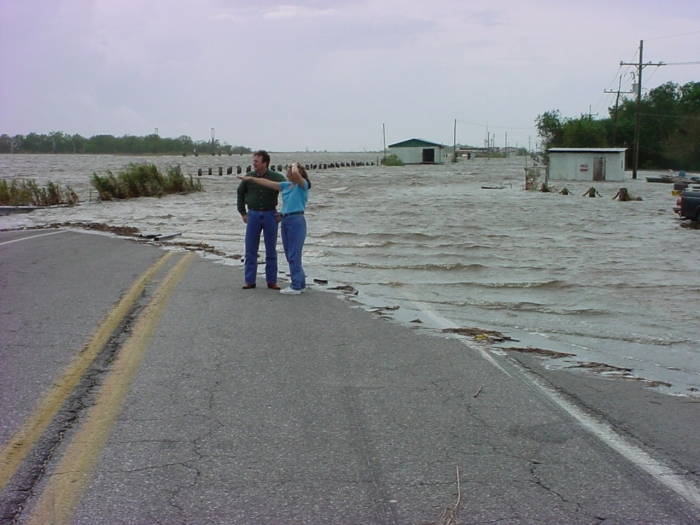 Storm surge on a Louisiana highway shows the affects of rising sea levels. (Credit: NOAA)