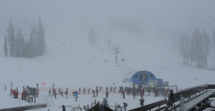 View of the Pine Marten Express ski lift from the balcony of the West Village Lodge at 6,300 ft altitude.