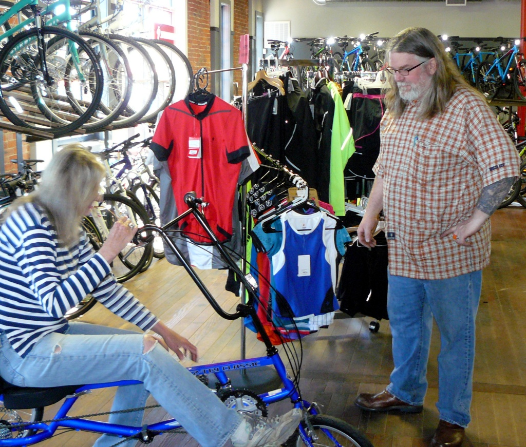 Eric at the store checking that the bike was properly set up for Jean.
