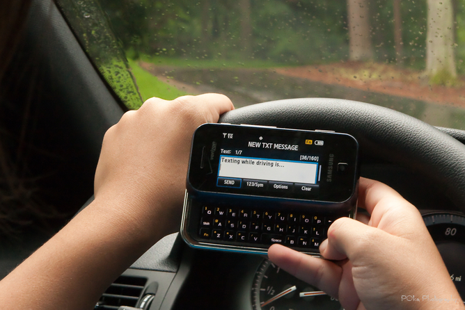 Really bad idea: texting while driving.  Paul Oka/flickr, CC BY-NC