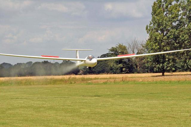 Modern fibreglass glider coming into land at Rattlesden G.C.