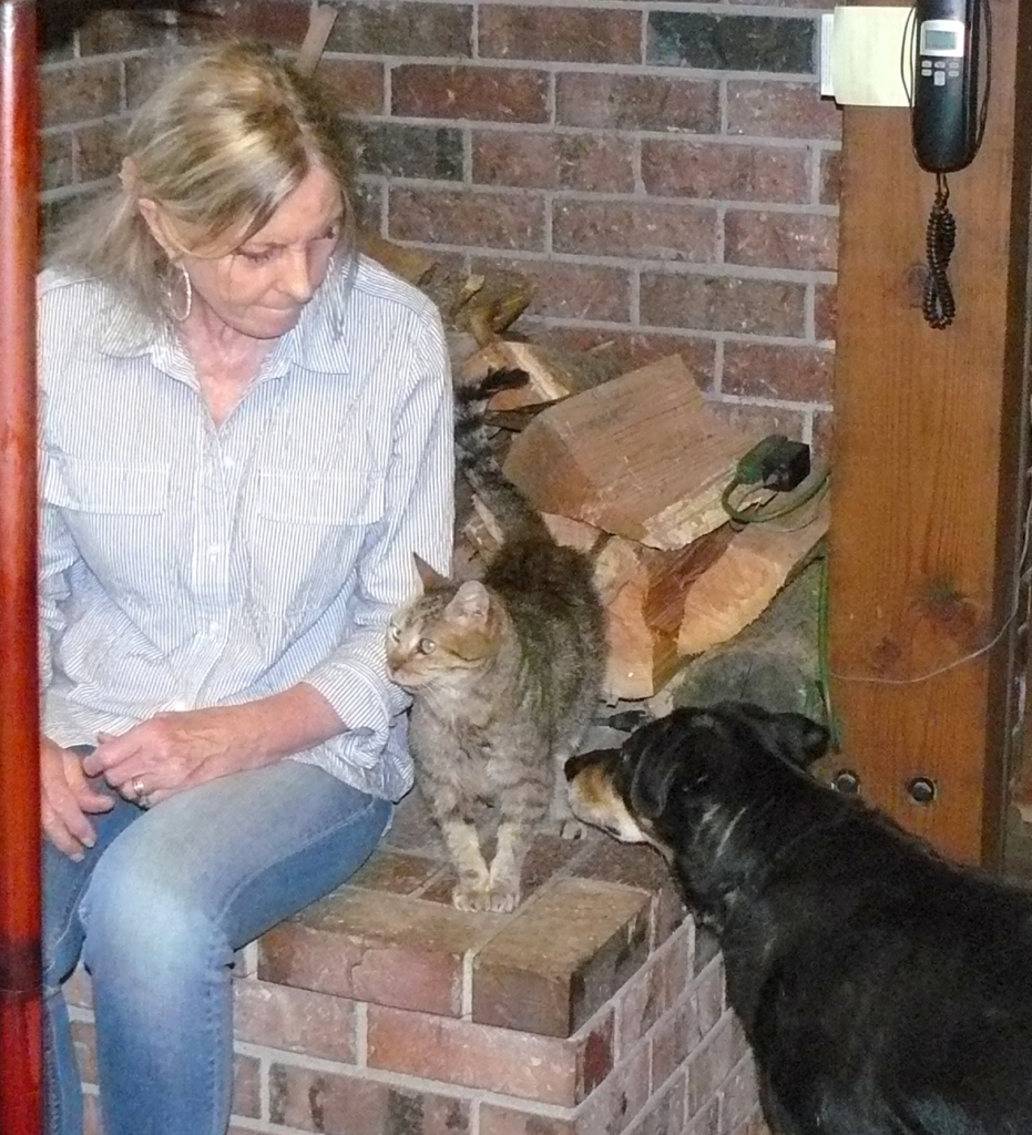 Jeannie, Hazel and cat feeling trust for each other.
