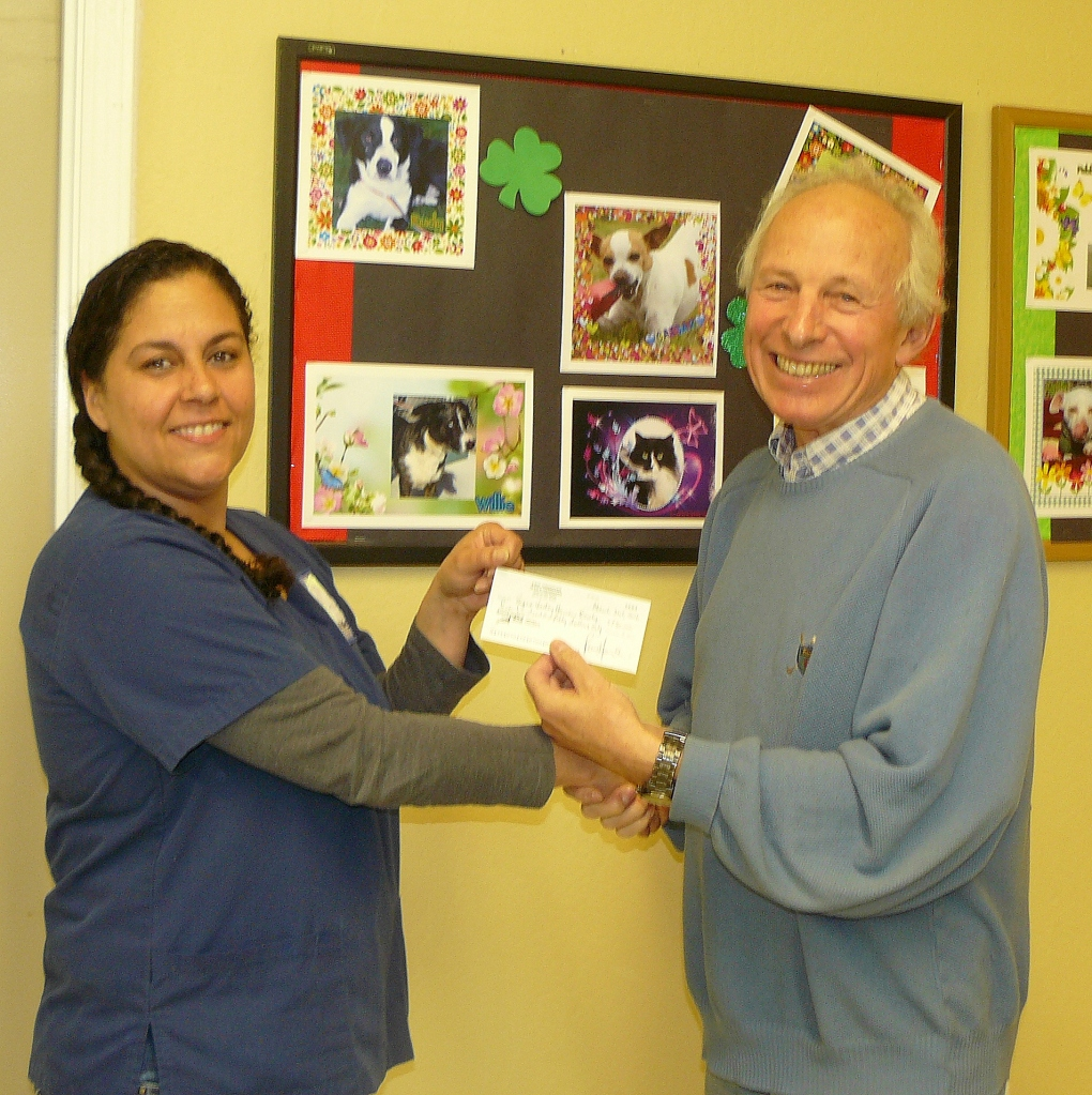 Yours truly passing a cheque to the value of $750 to Margaret Varner, Director of Facility Operations.