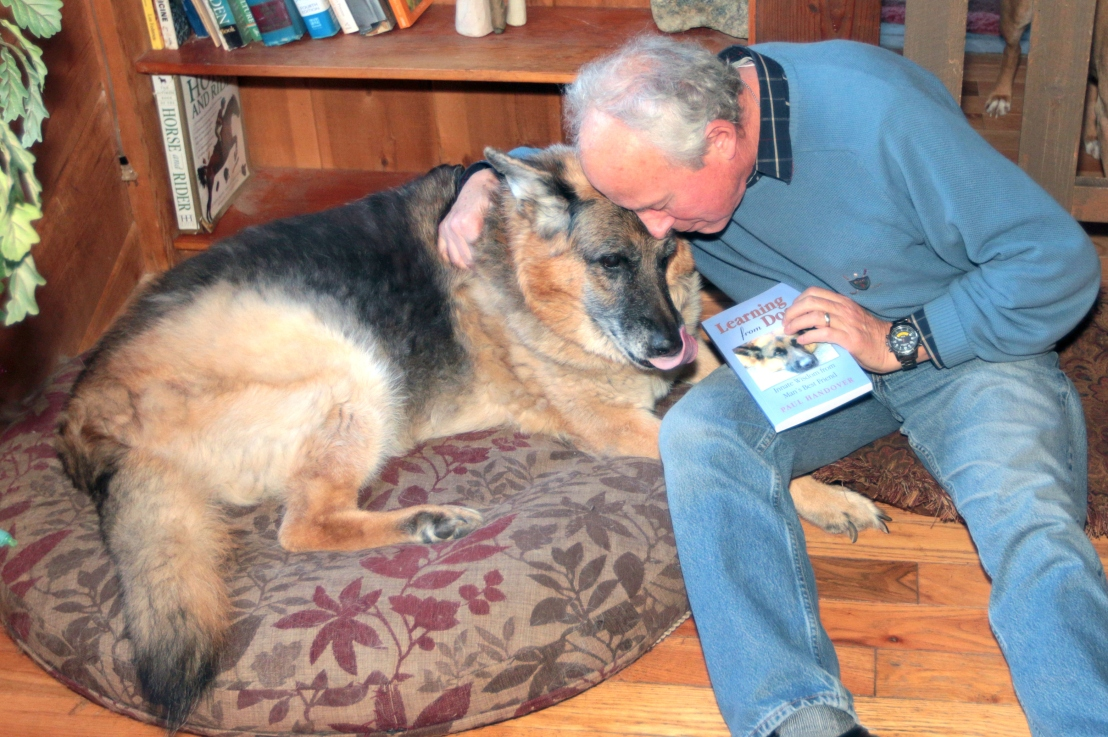 TIMOTHY BULLARD/Daily CourierPaul Handover with Pharaoh, a 12year-old German Shepard that he uses on the cover of his new book about man's best friend.