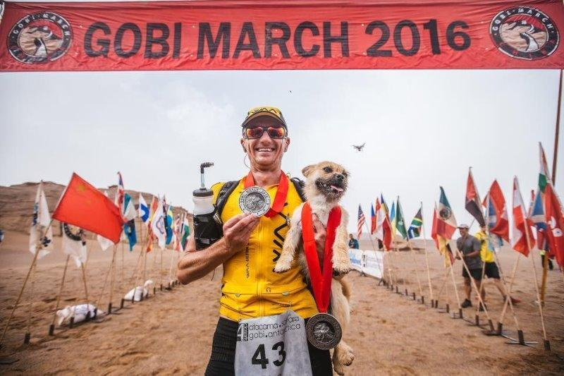 Mr Leonard hopes to be reunited with the dog who ran with him during the 250 kilometre race in the Gobi desert 4Deserts.com / Omni Cai