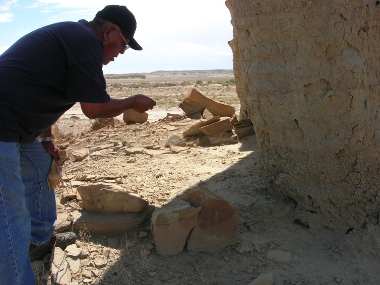 A Hopi elder making an offering to a snake to protect a sacred space. Chip Colwell, Author provided.