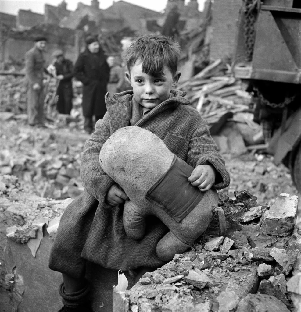 Toni Frissell's famous image of an abandoned boy clutching a stuffed animal in the rubble of 1945 London.