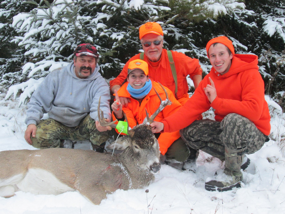 Three generations of a Wisconsin family with a nine-point buck. Wisconsin Department of Natural Resources/Flickr, CC BY-ND