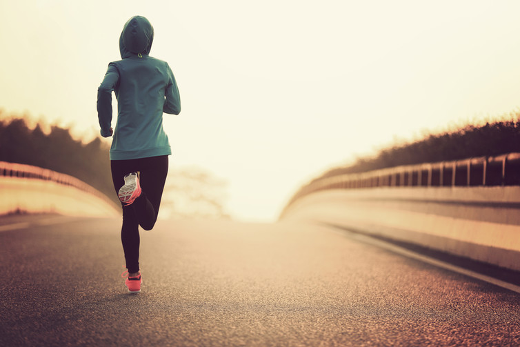 Up and at it. Female runner image via www.shutterstock.com.